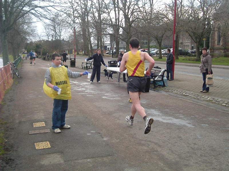 More Runners begin to arrive at the Water Station